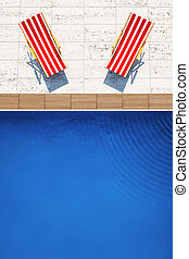 swimming pool with two beach chairs