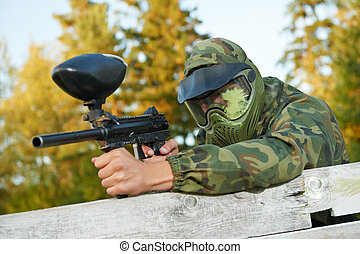 paintball player - paintball sport player in protective...