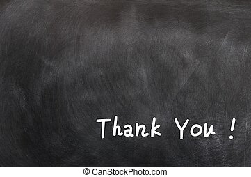 Thank you written on a blackboard - Thank you written in...