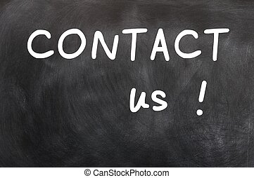 Contact us written with white chalk on a blackboard