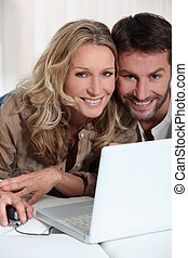 Couple in front of laptop
