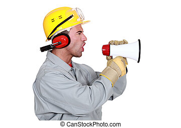 Manual worker shouting into megaphone