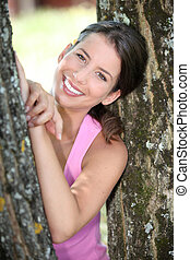 a sporty woman between two trees