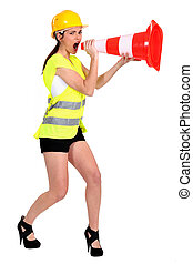 beautiful craftswoman shouting in construction cone