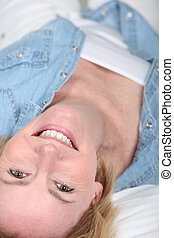 mature woman lying in her bed