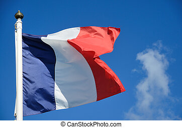 French flag - A french flag glowing o a blue sky
