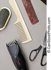 barber's accessories - Some barber's accessories over gray...