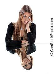Woman sat thinking