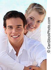 Smiling young couple in white