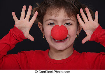 little girl with red nose playing clown