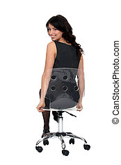 Attractive woman sitting on a see-through swivel chair