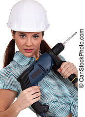 Woman posing with a power drill