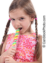 Girl eating a lolly pop