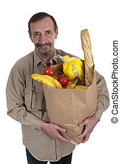 elderly man with a bag full of groceries