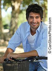 A man biking in a park.