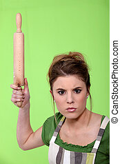 Annoyed woman with a rolling pin