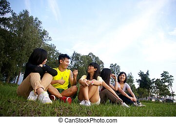 Asian friends talking at countryside
