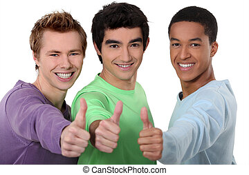A group of young men giving the thumbs up
