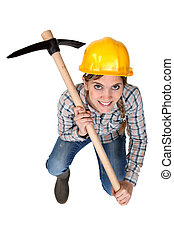 A female construction worker with a pickaxe