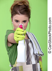 Young woman with spray cleaner