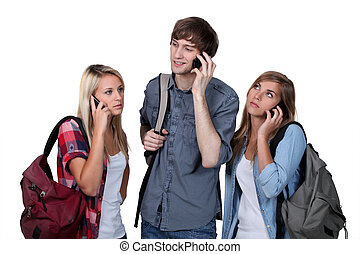 Young people on mobile phones