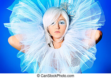 jabot - Portrait of an extravagant blonde model over blue...