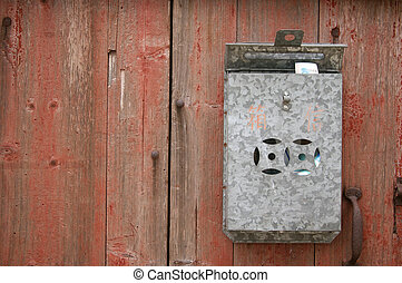 Postbox on wall