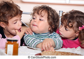 Children eating pancakes