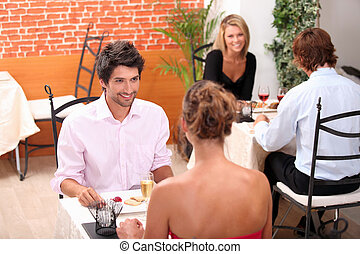 Couples eating in a restaurant