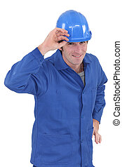 Smiling workman on white background