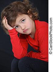 Little girl sulking.