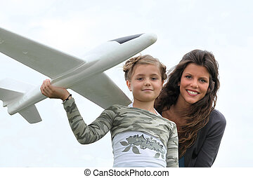 Girl with model aeroplane