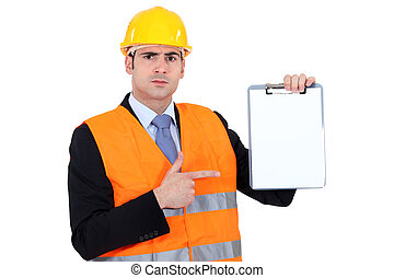 Engineer pointing to a clipboard