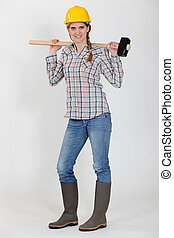 Tradeswoman carrying a mallet