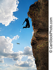 Rock Climber - rock climber climbs the steep cliff to the...