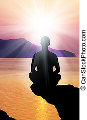 Silhouette of the meditating person