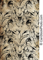 Tattoo pattern with gargoyle designs over antique paper -...