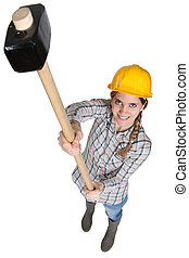 Female worker with a sledgehammer