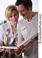 Couple looking at cookery book
