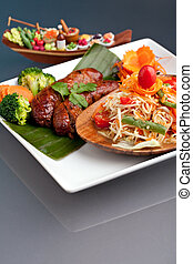 Thai Sausage with Som Tum Salad - Plate of freshly prepared...