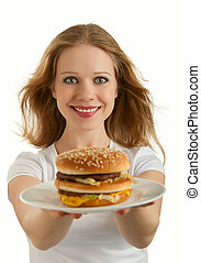 attractive girl holds out a plate of fast food, hamburger isolated on white background