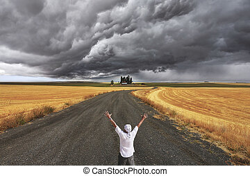 The enthusiastic tourist welcomes thunderstorm above Montana...