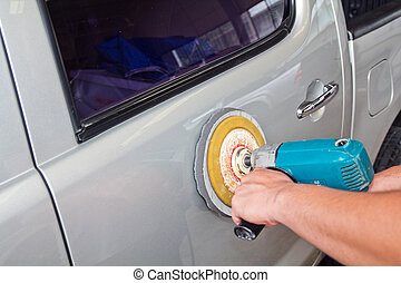 Polishing the car. with power buffer machine . CAR CARE...