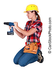 Woman with a cordless drill