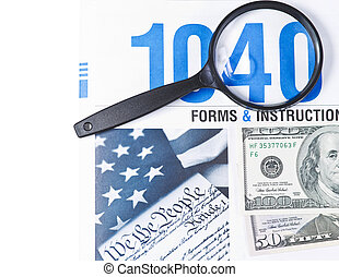 Money and Taxes - Tax form booklet 1040 with magnifying...