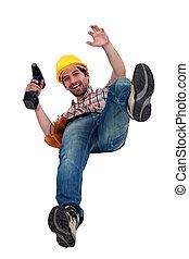A manual worker falling.