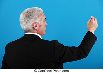 Businessman writing on an invisible board