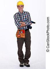 Young worker holding cordless drill