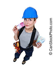 Female electrician with cash