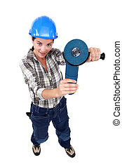 Woman holding angle-grinder